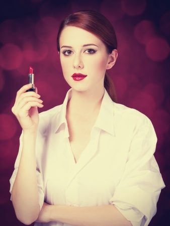 Redhead girl with lipstick photo