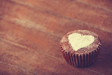 Cake with heart. Photo in old color image style. photo
