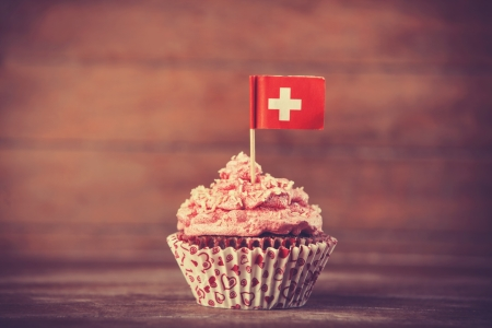 svizra: Cake with Suisse flag. Photo in vintage color style