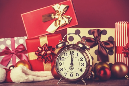 wood tick: Vintage clock on christmas background. Photo in retro color image style.