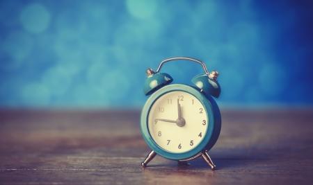 Retro alarm clock. Photo in retro color image style