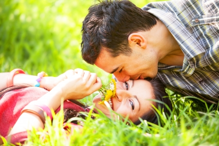 Couple Relaxing on Green Grass.Park.