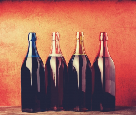 pinot: Four different bottles with young wine.