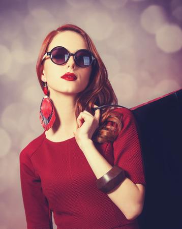 Beautiful redhead women with shopping bag Stock Photo