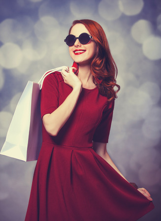 Beautiful redhead women with shopping bag photo