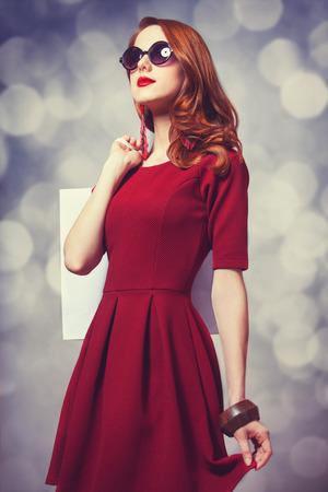 Beautiful redhead women with shopping bag photo