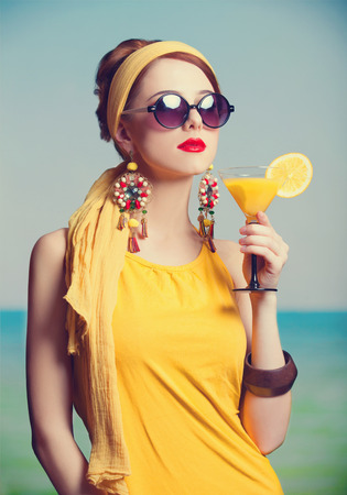 Rehad women with coktail. Photo in retro color style. photo
