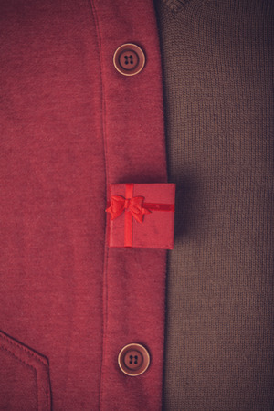 Buttons and red gift. Photo in retro color image style. photo