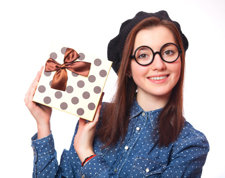 Brunette teen gift in glasses with gift. photo