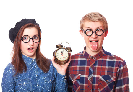 Teen couple with clock alarm. Isolated.