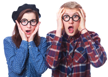 Nerd teen couple in glasses. Isolated photo