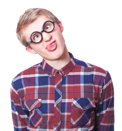 Young teen boy in nerd glasses. Isolated on white. photo