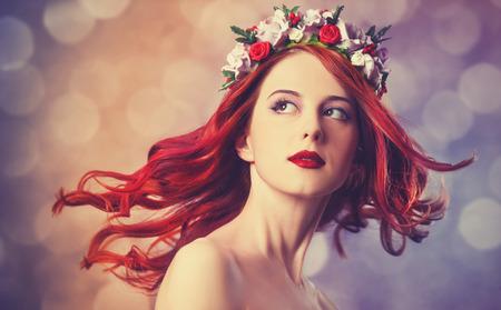 Beautiful redhead women with wreath. photo