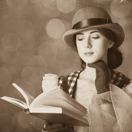 Beautiful women with book. Photo in retro style with bokeh at background. photo