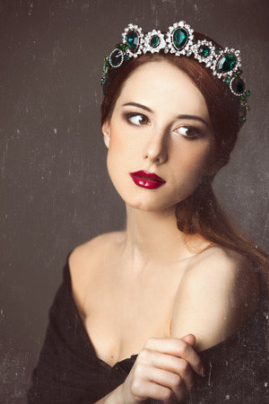 Portrait of a young women with crown. Photo in old color image style. photo