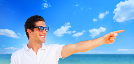 beach hunk: Handsome young man at beach background Stock Photo