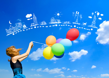 sky brunch: Redhead girl with colour balloons at blue sky background.