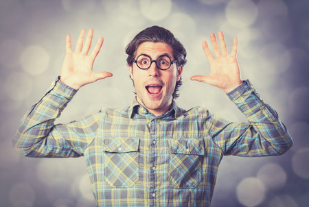 Portrait of funny man in glasses on gray background. photo