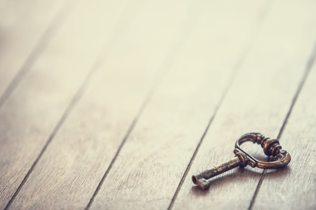 key on a wooden background