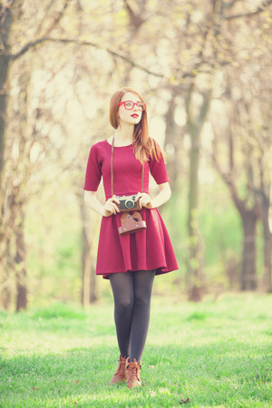 Redhead women  in a park photo