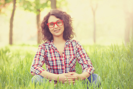 indian summer: Indian girl with glasses in the park. Stock Photo