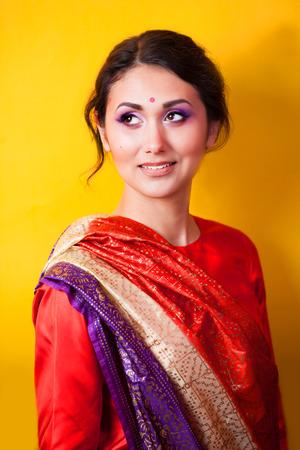 Indian girl on yellow background Stock Photo