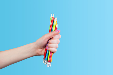 Hand holding color pencils  photo