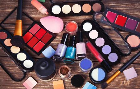 aureate: Cosmetics on wooden table. Stock Photo