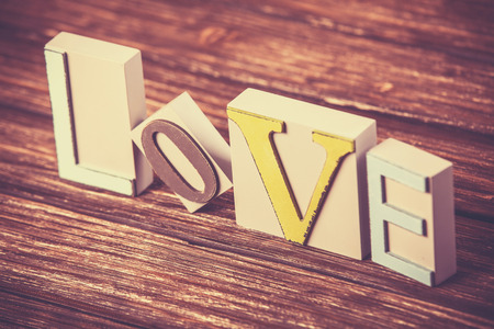 Word love on wooden table. photo