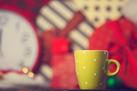 Winter tea in a cup and christmas gifts on background. photo