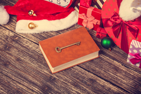 chirstmas: book and key with chirstmas gifts