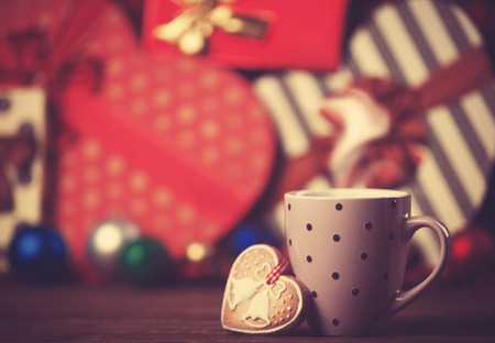 Cup of coffee and cupcake on christmas background. photo