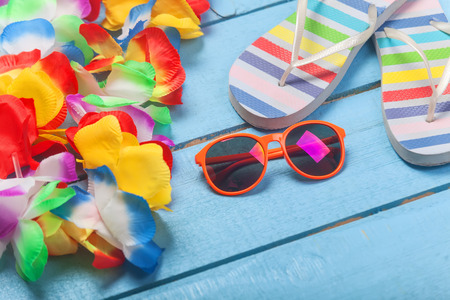 swimming shoes: Lei, sunglasses and slippers Stock Photo