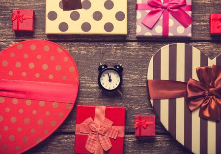 Retro alarm clock and christmas gifts around photo