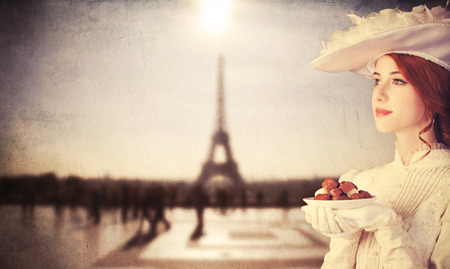sweettooth: Beautiful redhead women with candy in Paris