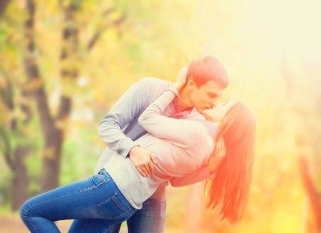 couple kissing outdoor in the park photo