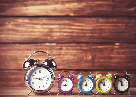 8 years old: Retro alarm clocks on a table. Photo in retro color image style