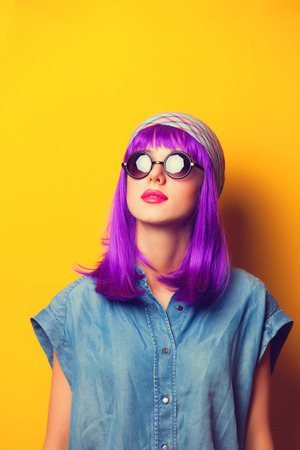 bandana girl: Beautiful girl with violet hair in sunglasses on yellow background. Stock Photo