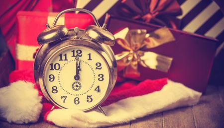 Vintage clock on christmas background photo