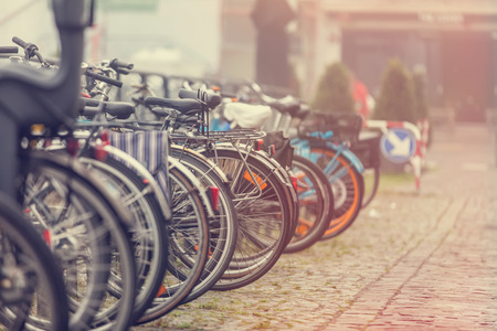 stationary bike: Group of bikes in parking in Amsterdam Stock Photo