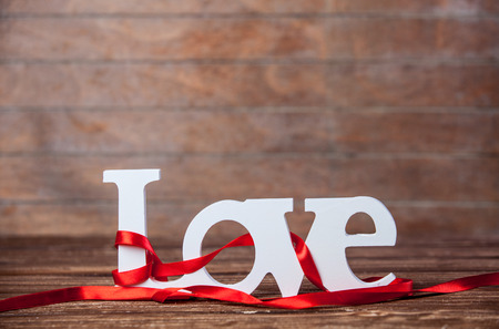Word Love and stripes on a table. photo