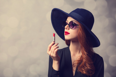 Style redhead women with sunglasses and lipstick. Stock Photo