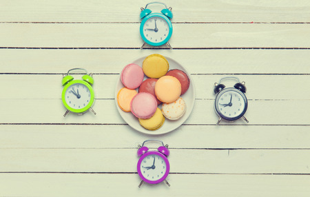 Clock and macaron with christmas toys. photo