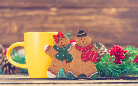 Couple of gingerbreads near cup of coffee photo