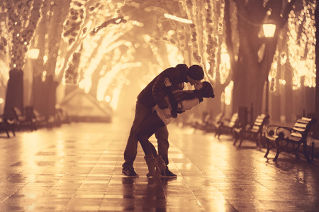 Couple kissing at night alley. photo