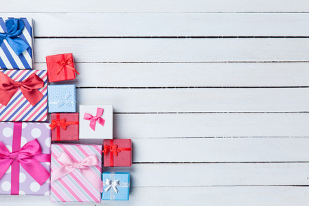 over white background: Gift boxes on white wooden background