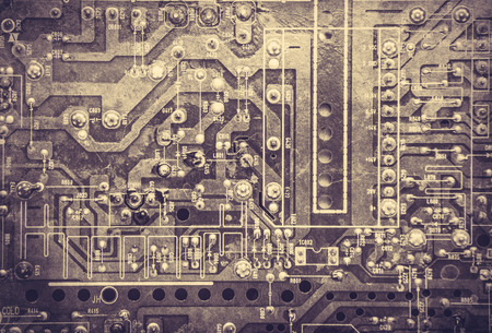 computer part: Old printed circuit board. Photo in old color image style.