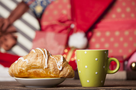 traditionally french: Cup of coffee and croissant on christmas background. Stock Photo
