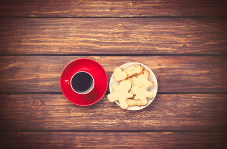 woden: Cup of coffee and cookies on woden background. Photo in old color image style. Stock Photo