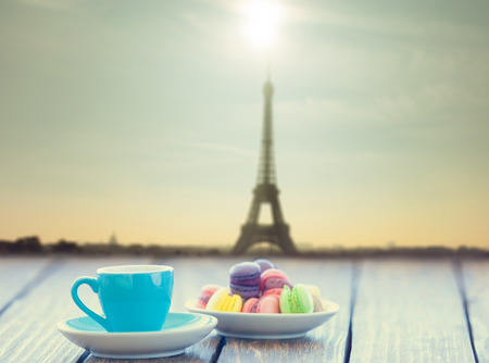 pink vintage background: Cup of coffee and macarons with Eiffel tower on background Stock Photo